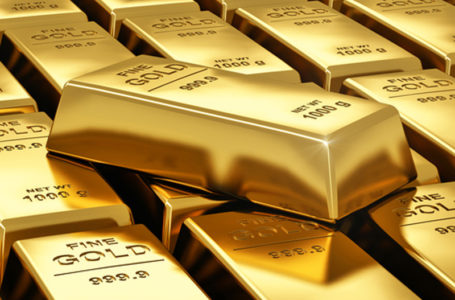 Gold flirts with 11-month lows after superb U.S. records